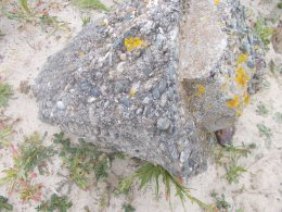 Definitely a bit of WW2 concrete - see the mix of sand and pebbles from the nearby beach?